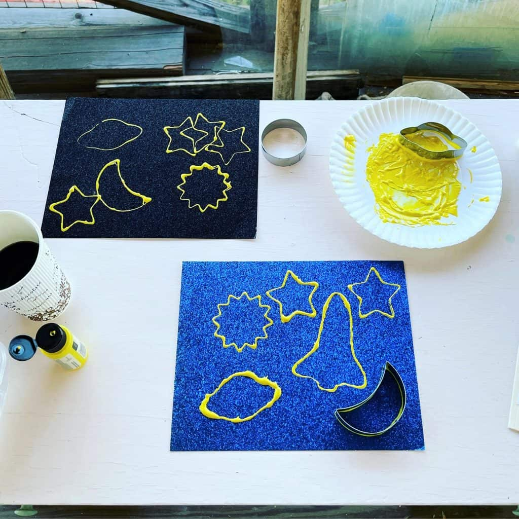 Cookie Cutter Painting for preschool outer space craft.